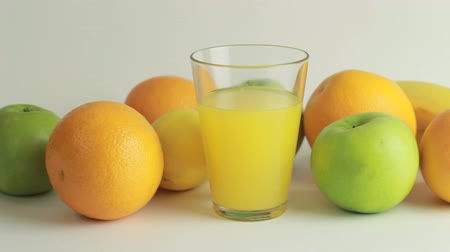 vitaminic : Orange juice and fruits on a white background HD