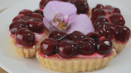tartlet : Cherry dessert rotating on a white plate