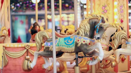 go to school : Traditional Vintage Carousel with Colorful Wooden Circus Horses. Entertainment, holidays, joy concept.