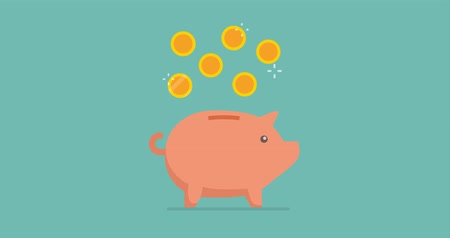 Coins falling into a piggy bank: earning, saving and deposit concept