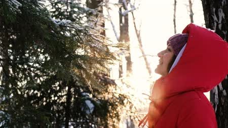 breathing fresh air : A beautiful girl enjoys the fresh air in the winter forest, exhales couples from her mouth, slow motion