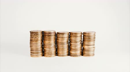 stock raising : Stop motion rising stack of gold coins, rising investment and increasing profits on a white isolated background