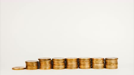 stock raising : Stop motion rising stack of gold coins, rising money investment and increasing profits on a white isolated background