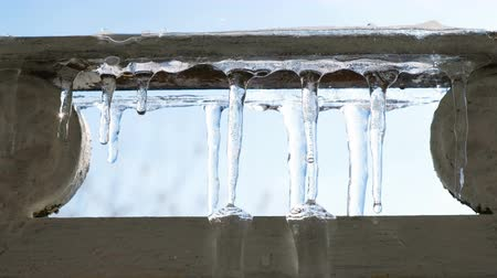 melts : Dripping icicles, icicles melting on the balcony, spring drops, thawing