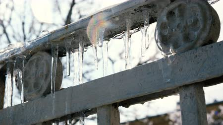 melts : Dripping icicles, icicles melting on a balcony in an old historical building, spring drops, thawing Stock Footage