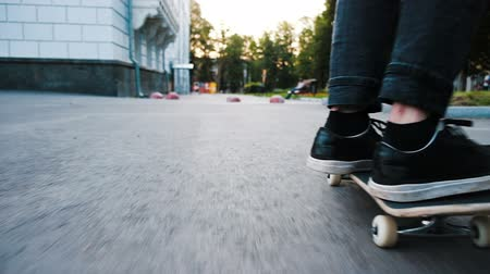 kickflip : Man on a skateboard performs an ollie flip - trick kickflip leap on a board across an obstacle close up, slow motion. Stock Footage