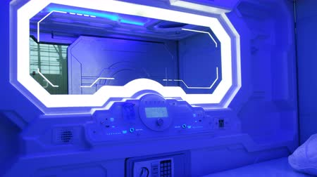 separado : Sleepbox with neon lights, space capsule for sleeping at the airport, inside view Stock Footage