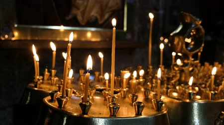 louvor : Wax candles burn and stand on the sand in the censer of the Orthodox ancient temple