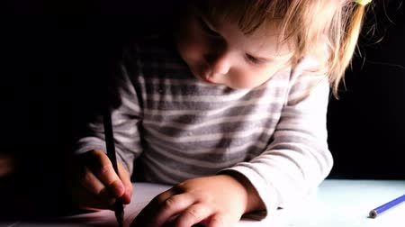 dikdörtgen : Little children preschoolers draw together, baby girl diligently draws a pencil, close-up