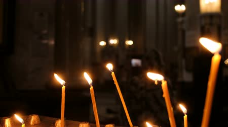 madona : Candles are burning in the old Christian church