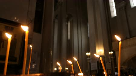 stained glass : Defocus candles are burns in an Orthodox church against the wall of the high temple