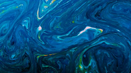 rozptyl : Neon psychedelic paints are mixed in a black liquid, abstract patterns spread