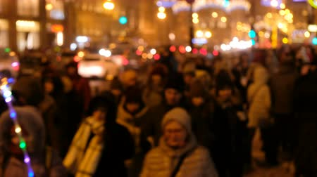 establishment : Crowds of people go from work to a busy street, in defocus, nightlife of the metropolis Stock Footage