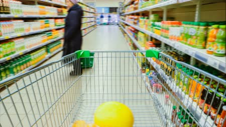 aisles : Time Lapse of the Shopping Cart Moving Between Various Aisles and Section in the Big Supermarket. Inside Trolley Various Healthy Items and Convenience Food.