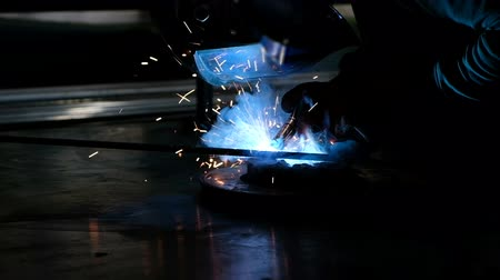 laboring : Slow motion shot of arc welding process in production