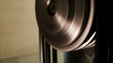 cogwheels : Movement Of Metal Wheel and Belt In A Mechanical Device. Gearbox Stock Footage