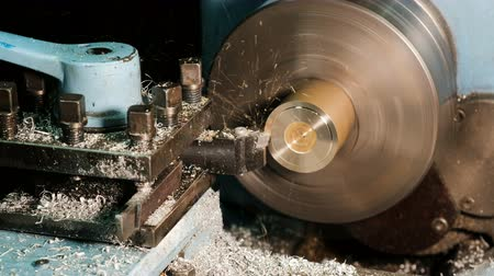 fitter : Lathe in action. Processing brass billet. Stock Footage