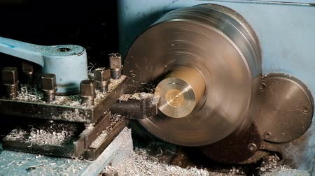 fitter : Lathe in action. Processing brass billet slow motion