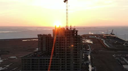 reinforced : Aerial view of the building under construction at sunset, Dolly zoom effect