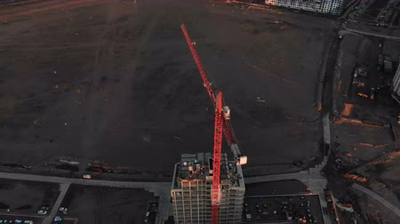 wasteland : Epic flight over the construction crane,. on the construction of a building, shooting with the drone