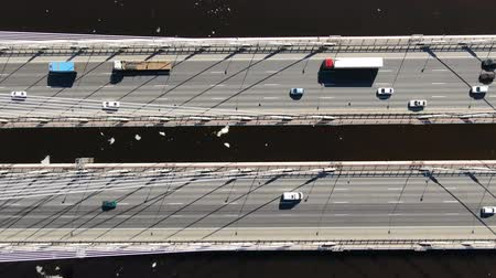 stayed : Cars driving on cable-stayed bridge, aerial view.
