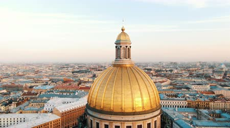 St. Isaacs Cathedral in St. Petersburg at sunset, aerial view, a beautiful flight around the dome of the cathedral.