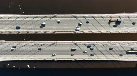 Aerial shooting over the cable-stayed bridge, traffic of cars driving over the water Stock Footage