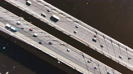 Static view from above a cable-stayed bridge, aerial shooting over traffic from cars