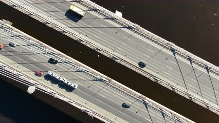Aerial shooting over the cable-stayed bridge, zoom out from the cars over the river Stock Footage