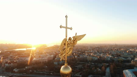 Flying around an angel on spire of Peter and Paul Fortress at sunset, close-up. Panorama of St. Petersburg Stock Footage