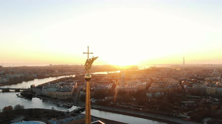 Flying over the Peter and Paul Fortress near the angel at sunset. The historical center of St. Petersburg, aerial shooting