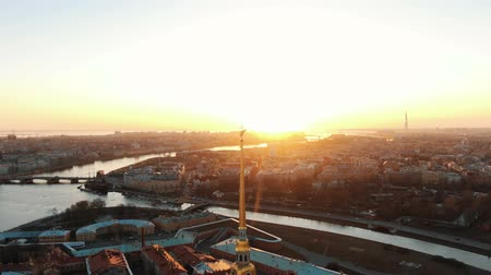 Flying over the Peter and Paul Fortress near the angel at sunset. The historical center of St. Petersburg
