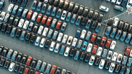 apertado : tight coloured car rows on parking area vertical upper view