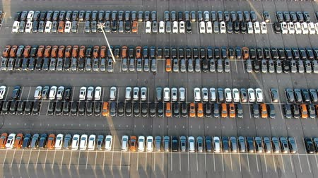 cercar : picturesque storage parking with coloured car rows aerial
