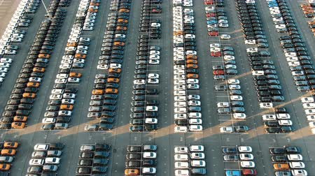 warehouses : different car rows parked on finished auto warehouse area Stock Footage