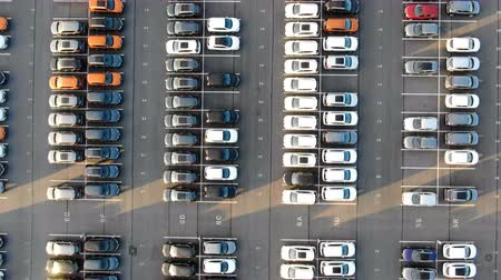 deposito : large storage area of different coloured automobiles