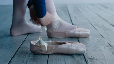 toes : professional ballerina hands tie white pointe shoes ribbons