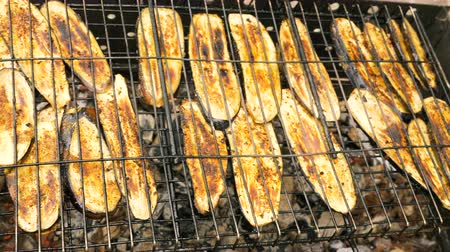 charred : Sliced eggplant is grilled on a charcoal grill Stock Footage