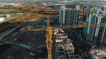 inacabado : round aerial view high cranes build new dwelling complex Stock Footage