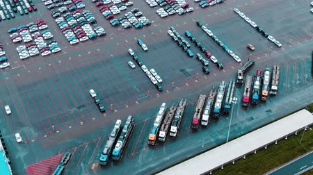 megjelölt : cars drive and park on huge open parking lot aerial view