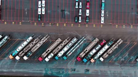 szervez : car transporter trucks stand on huge parking lot aerial view