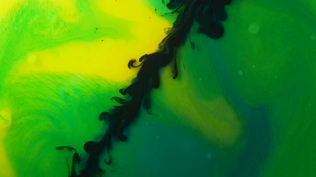 stain : amazing black ink path on colorful rainbow yellow and green