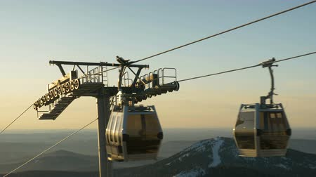chair lift : Ski lifts close-up on the background of mountains and forests, ski resort