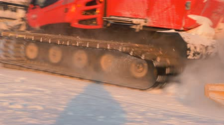 snowcat : modern red snowmobile with flashing orange lights drives