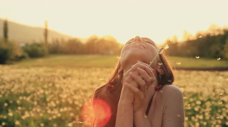 dmuchawiec : Beautiful Young Woman Blowing Dandelion Laughing on a Summer Field HD