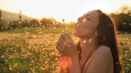 dmuchawiec : Young Female Model Blowing Dandelion Laughing on a Summer Field HD