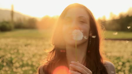 dmuchawiec : Pretty Girl Model Blowing Dandelion Laughing on a Summer Field HD
