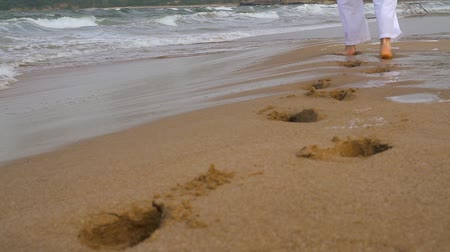 mise : Footsteps Made in Sand by Man in White Religious Concept Background HD