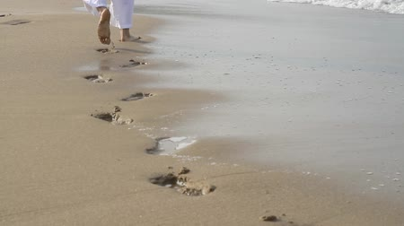 ищу : Man Walking on Beach Footsteps Covered by water HD