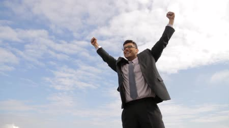 taş : Business Blue Sky Success Celebrate Young Businessman Concept Background HD Stok Video